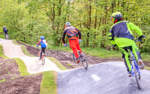 Cyclists on dips on BMX track